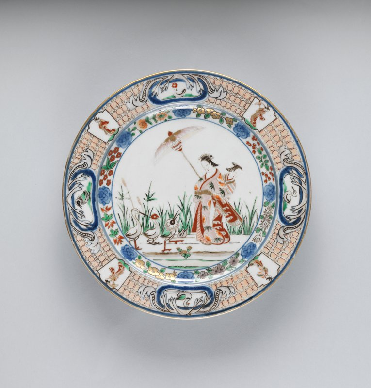 plate with design of courtesan with attendant in floral kimono standing among reeds; attendant holds pink parasol for courtesan; reeds behind the two women; waterfowl to the L; floral inner border within plate; outer border with alternating cartouches of young women and waterfowl; insects on underside