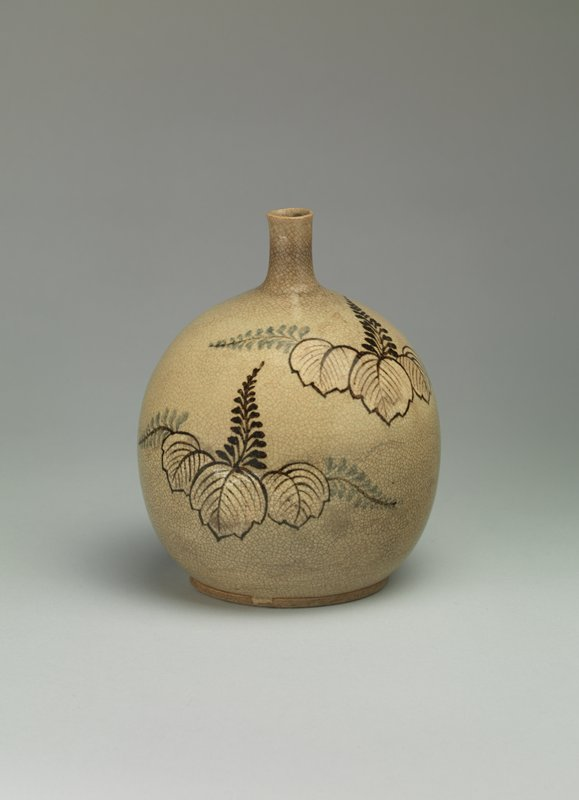 short, round bottle with narrow neck; beige glaze with paulownia leaves and blossoms in black and blue