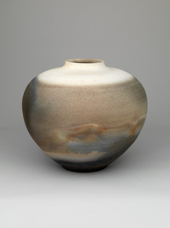 squat jar with narrow base, rounded, wide shoulder, and short, gently curving neck; gray gradient glaze with area of blues and browns; dark bottom