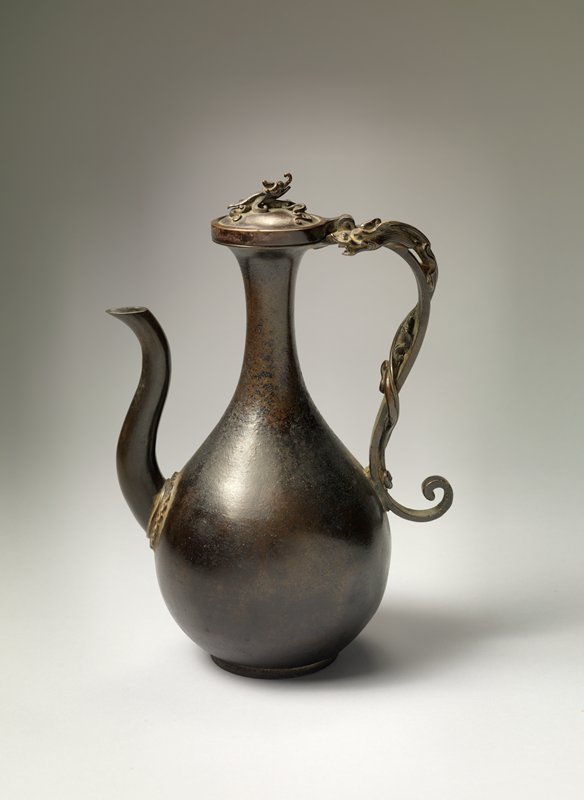 long-necked ewer with motif of dragons on handle and lid; bulbous body, gently curving spout with scalloped design around base