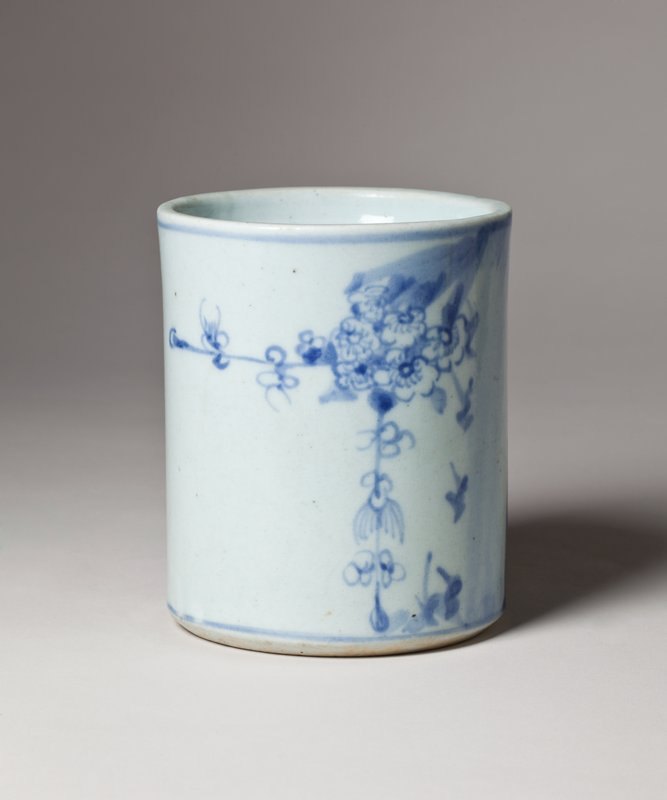 white jar with two blue bamboo stalks on one side; blue tree with plum blossoms