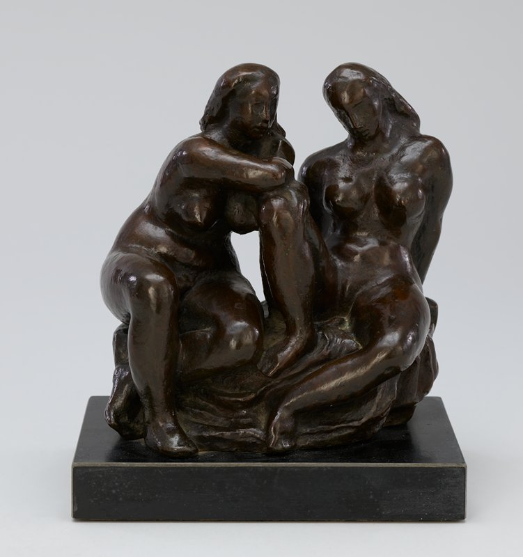 two nude women seated on a rock; woman at right has PR knee drawn up and is leaning back with her weight on her hands which are behind her; woman at left leans her PR elbow on PR knee of first woman, and has her PL foot drawn slightly back