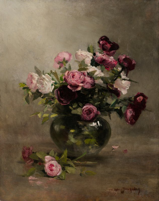round glass vase with white, pink and maroon roses; maroon and pink roses lying outside of vase in lower left; grey ground