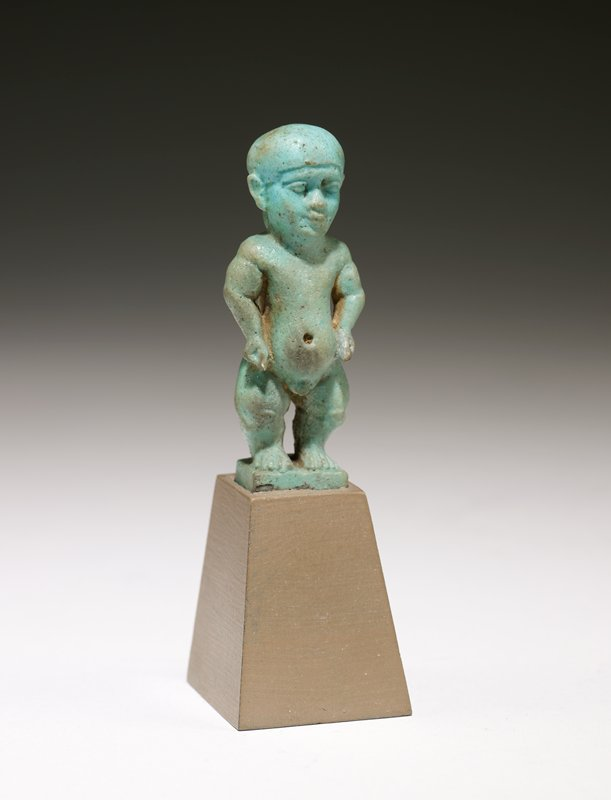 Amulet, faience, Egyptian, Ptolemaic, century? cat. card dims H. 2-5/16', W. 7/8' Same God as 16.112. blue, pierced piece on back for suspension. one of the children of the deities, Ptah and Bast One of the children of the dieties, Ptah and Bast