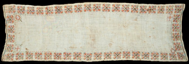 Towel, loosely woven linen. Embroidered with a border of square floral motifs set closely together. Worked in pink, blue and green silks and tinsel thread.