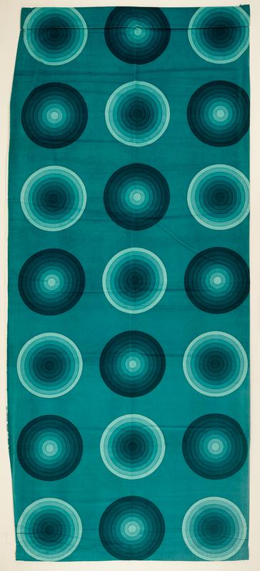 large-scale pattern with horizontal and vertical rows of concentric circles (three across, seven vertically), alternating either from light to dark shades of teal or dark to light shades of teal; medium teal ground