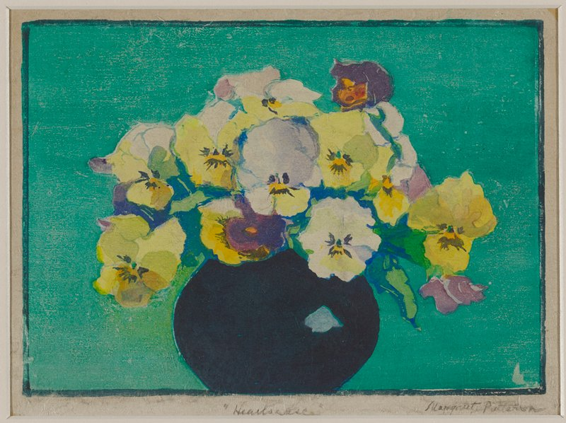 bouquet of yellow, purple and white pansies in a round black vase; turquoise ground