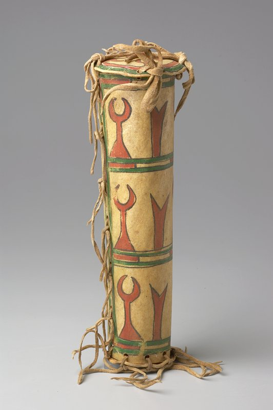 tube-shaped container, slightly smaller in diameter at bottom; tied at top, bottom and side with leather thongs; decorated with repeating geometric patterns in 3 rows on body, in red, green and black