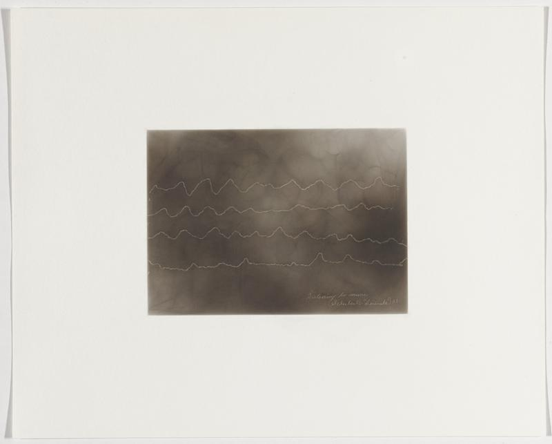 smoky grey background; four shaky zigzagging white lines