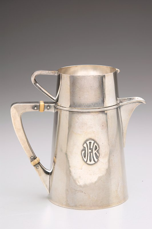 bottom section is pitcher with pierced spout; slightly tapering cylinder; wedge-shaped handle with 2 ivory bands; top section is small, slightly tapering pitcher with very small spout and wedge handle