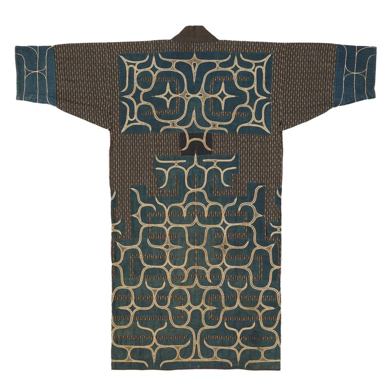 robe with brown striped base fabric and navy blue applique trim on sleeve cuffs, bottom half of body, and back center, all with beige, light blue, and yellow curving embroidery patterns; solid brown collar; patched lining of striped brown, brown plaid and solid blue fabrics
