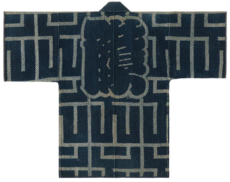 short, navy blue tightly quilted robe with intersecting, horizontal and vertical off-white line pattern, tan Japanese characters on collar, and outline of Japanese character on back center; red-brown interior lining with same tan pattern
