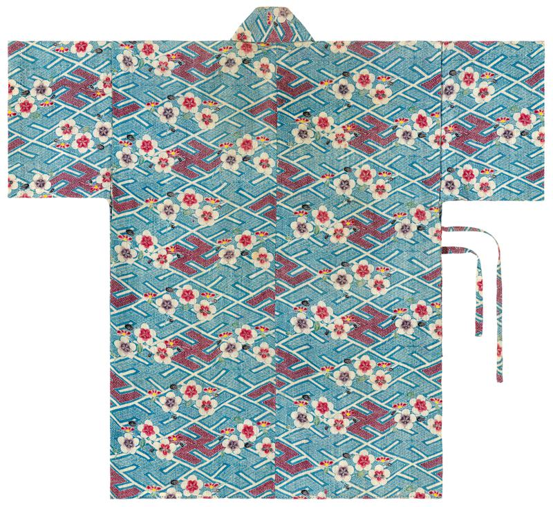 short robe with white blossom pattern over patterned background consisting of blue and red swastikas; fabric tie attached to PR side and PL opening edge