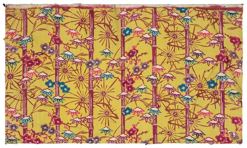 rectangular fragment of yellow fabric with bamboo and floral pattern; pink bamboo stalks with pink, purple, blue, and green leaves covered with snow, and blue, purple, and pink blossoms throughout