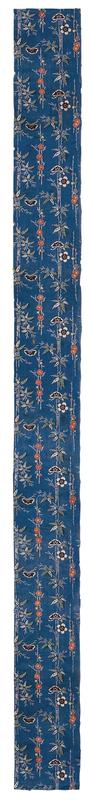 rectangular strip of blue fabric with vertical bamboo and floral designs; pattern consists of white bamboo with white and green leaves, with red, yellow, white, and black flowers and black butterflies