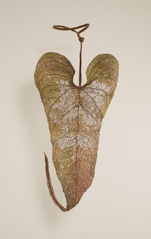 corset formed in the shape of a leaf; predominately brown