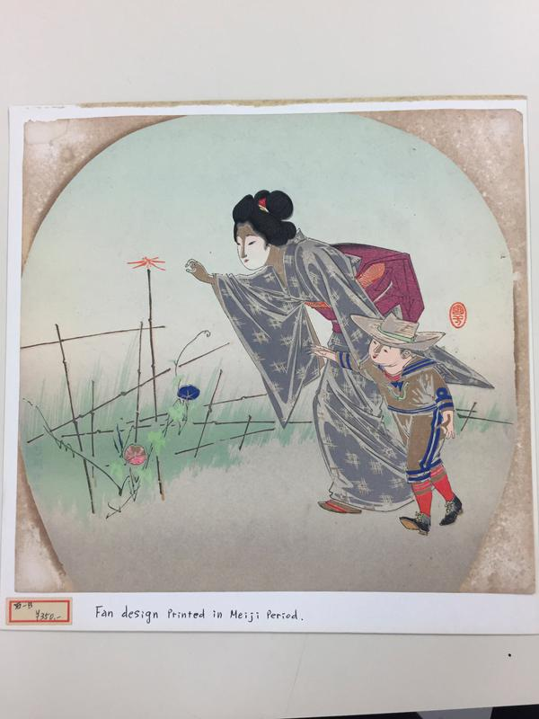 woman wearing kimono and little boy in western dress (sailor suit and straw hat) catching an orange dragonfly