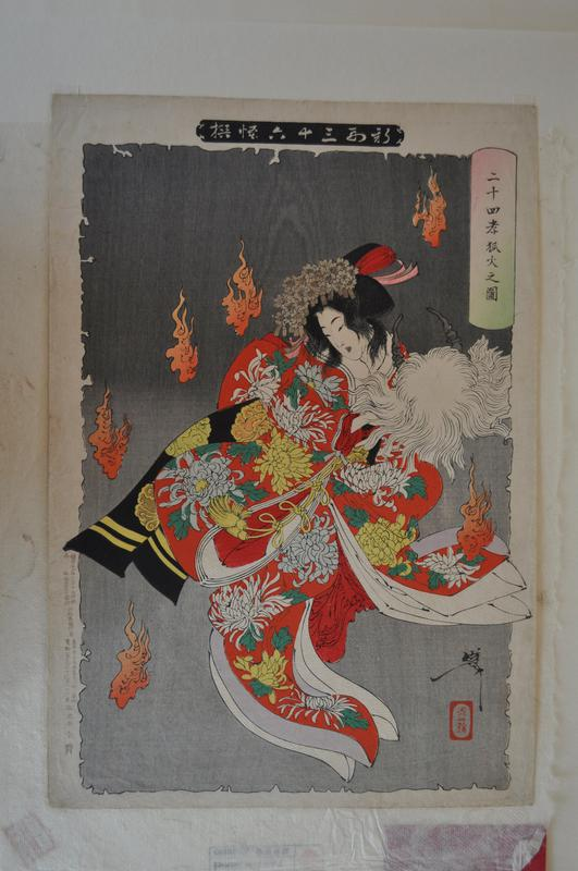 woman in red kimono dancing with six flames