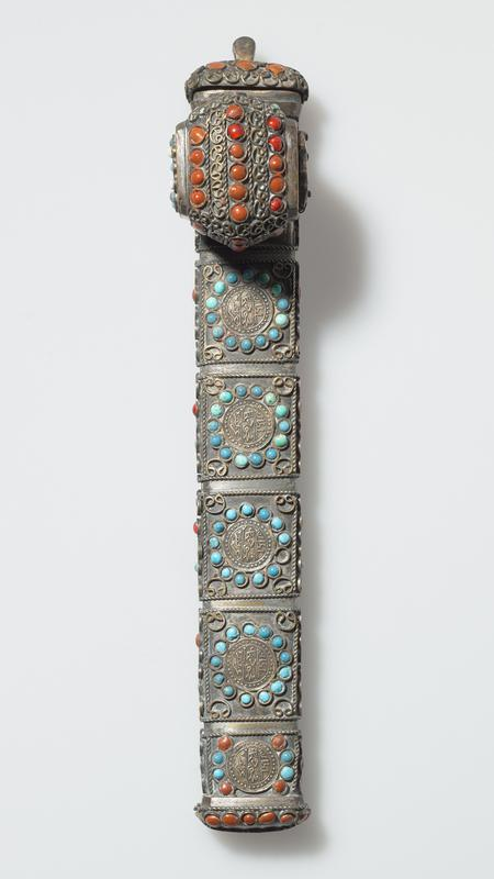 long case with attached rounded rectangular inkwell; red, orange, and turquoise round beads and gems; crescent and star designs on one side; medallions with text on opposite side; wire filigree