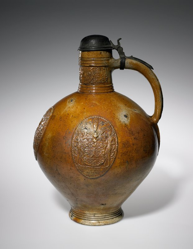 Jug, dated 1580, earthenware with salt glaze, decorated with band on neck and armorial medallions on front and sides