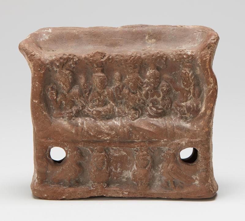 Seat, miniature size, with five figures above, two birds and two busts below all in low relief. Hollow, two holes at edge in lower frieze. Possibly Coptic.