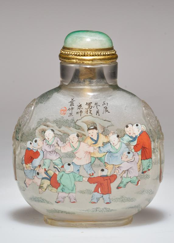 Snuff bottle. Crystal. Jade top. Hand painted figures inside. Signed and sealed.