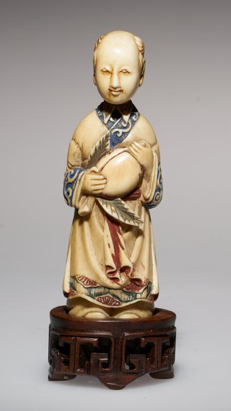 carved figure holding the peach, symbol of immortality, probably the portrait of a priest, or of one of the Immortals