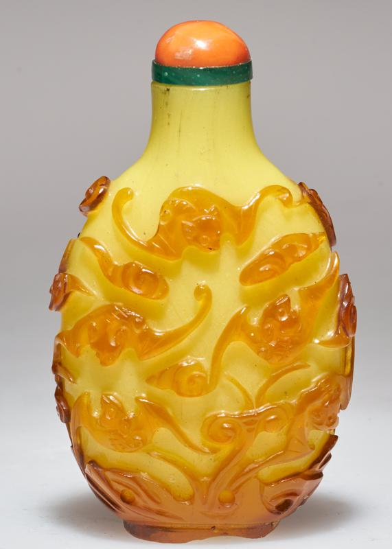 coral top; amber colored glass carved on yellow glass; bat symbols
