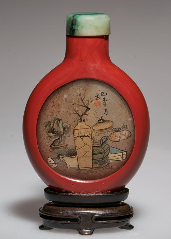 glass, with coating of red lacquer; green jade top; medallions cut from the lacquer; hand-painted scene on glass