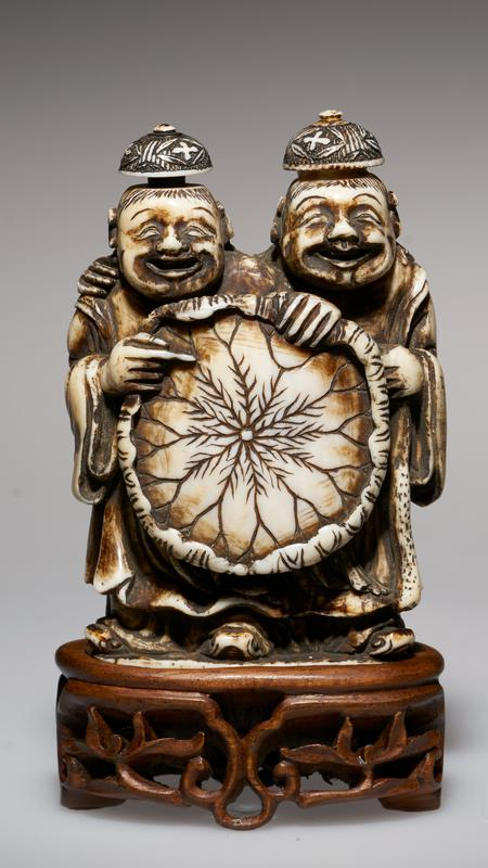 carved figures with caps as stoppers; holding lotus leaf; double snuff bottle