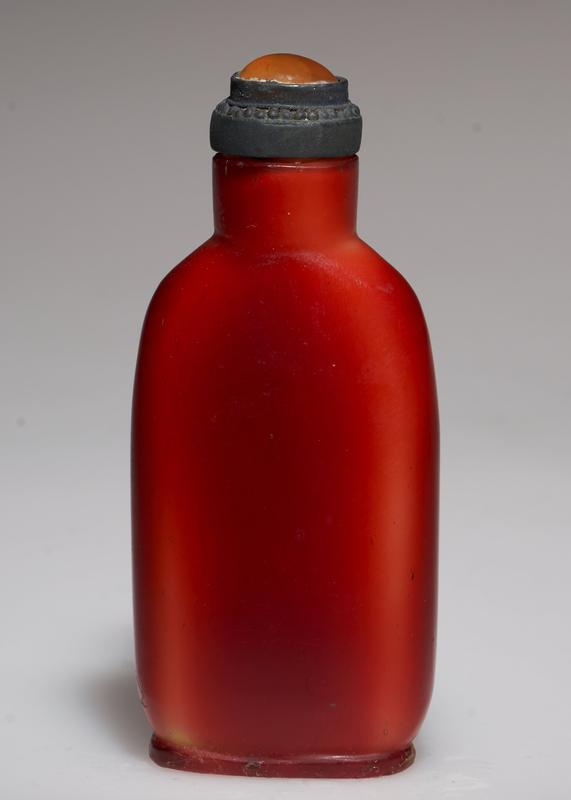 carnelian top in silver; yellow glass with red over-glaze to represent toucon beak