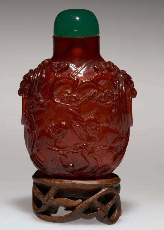 Amber. Green glass top. Carved.