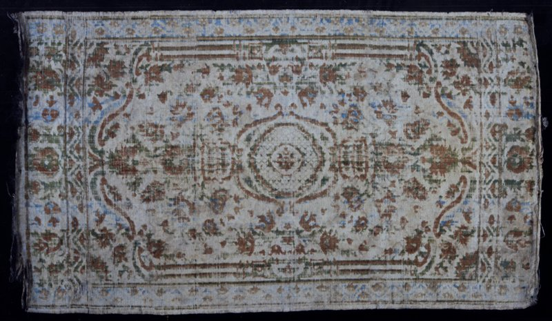 Panel, woven of velvet on cotton. On a yellow ground, a central medallion in rose, green and blue is surrounded by four vases of flowers in same colors. Floral border in same colors. Silk and cotton. N.B. These panels were sometimes used as prayer rugs.
