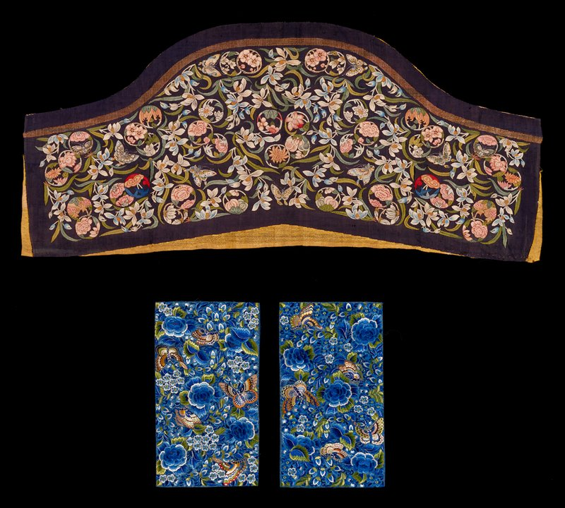 Small embroidered panel of blue silk damask closely worked with roses, leaves and butterflies, in colored silks, chiefly shades of blue and green.