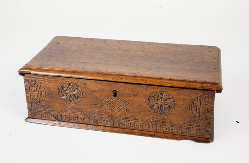 Bible box; front carved with simple geometric design of circles; carved pine