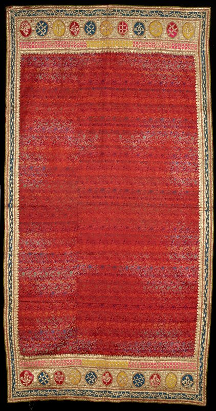 Panel of red silk brocaded with birds and floral sprays in white, purple, yellow, and green. Border of coarse embroidery of gilt tinsel braid at sides and both ends. The material has been washed and portions of it have been discolored giving it a 'changeable silk' effect.