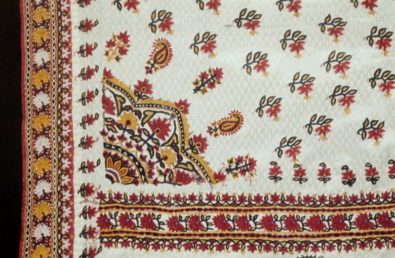 Pulchari, or woman's veil of white figured satin embroidered with rose-colored flowers in rows, a center medallion and borders of palmettes at top and bottomn. The embroidery is done in satin stitch.