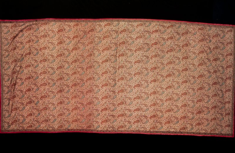 doshalla or long shawl; pink ground entirely covered with butha and fine floral sprays; narrow borders on sides and ends were woven separatly and added; backed with a piece of soft pink woolen which has a border of blue taffeta, and a binding which shows on the right side