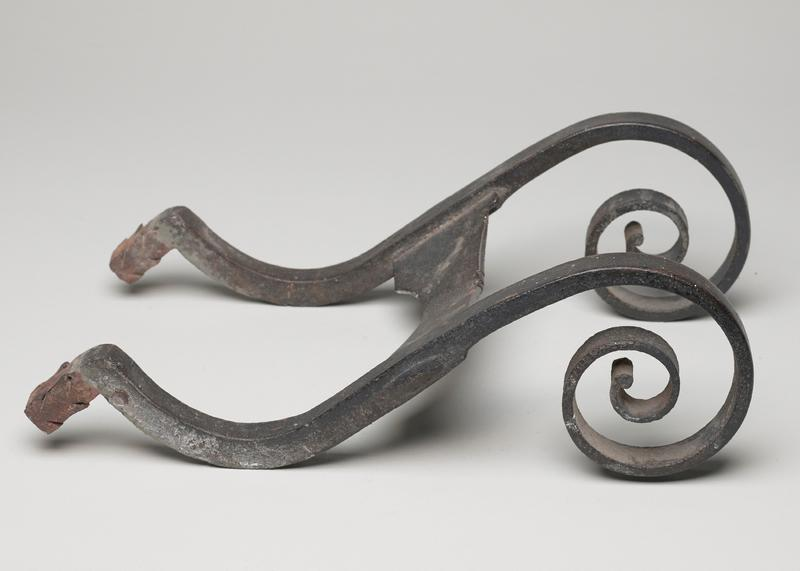 footscraper, two half scrolls, voluted, with horizontal bar between; said to have come from Virginia