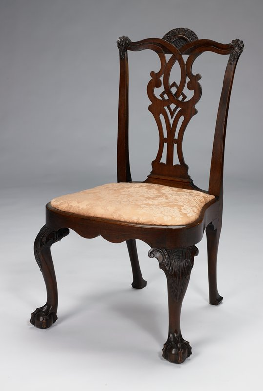 this chair is said to be one of a set of chairs owned by Sir William Johnson of Johnstown N.Y; see Catalog card and object file for details; black modern upholstery with cross-stitch flowers. This chair has been reupholstered to have pink fabric covering the seat.