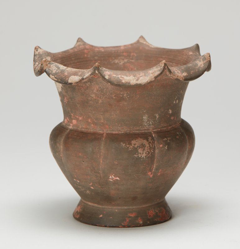 Coupe, pottery, with a floral lip opening, unglazed; graceful shape with fluted body.
