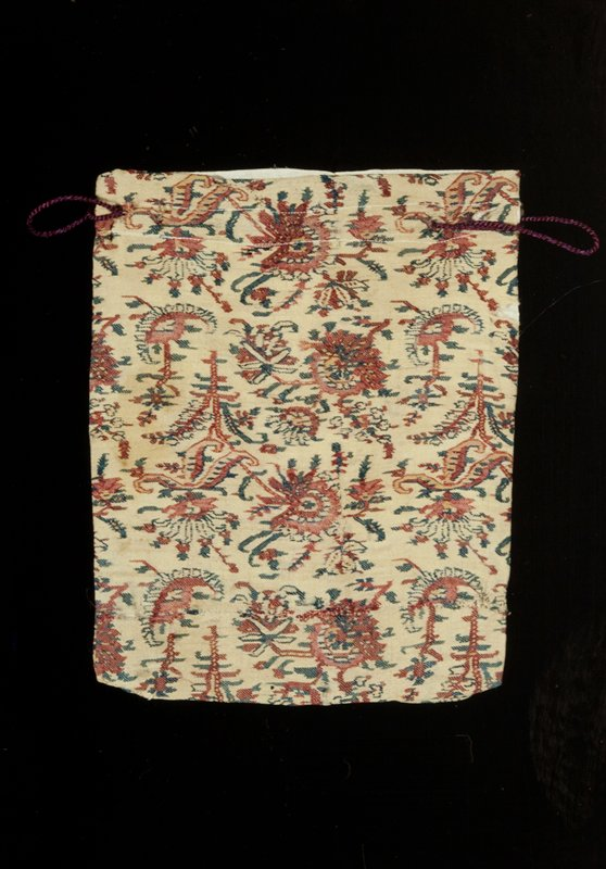 bag, piece of Kashmir shawl, cream ground with floral decoration in blue and rose, made up of regularly repeated sprays; bag made with material wrong side up; cream colored pongee lining; much worn and darned