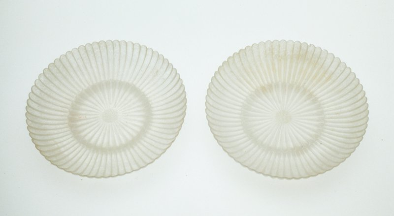 Dish, white camphor jade (one of a pair 36.7.2-3). Carved in chrysanthemum form and worked to proper thinness.
