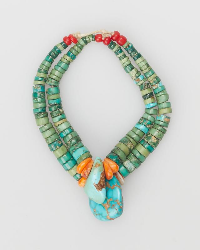 pair of earrings made of loops of small turquoise disc beads with one larger pendant turquoise flanked by two coral pendants; two red disc beads at top of one earring; four at top of other; strung on string