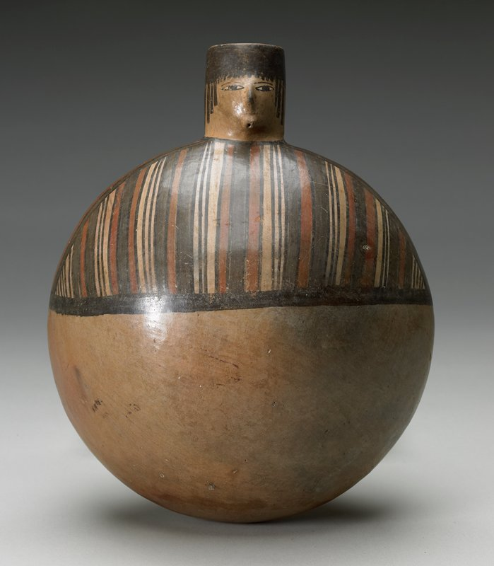 Large oval jar with the neck representing a human head. The face is slightly modelled, with nose and chin in full relief, but with eyes and hair painted. The upper section of the jar is painted to represent a poncho worn over the shoulders. The poncho is striped vertically in dark brown, rust, and cream on the front and in the back in stripes of dark brown only, possibly to represent the hair of the figure. This jar is interesting as illustrating the manner in which ponchos were worn. Late Nazca per Schoeler--MWS.