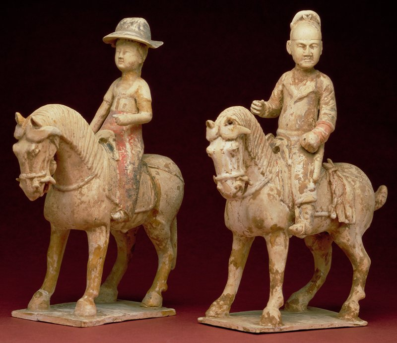 Hunter with quiver, rabbit and pheasant hanging from saddle. Buff colored earthenware with glaze and traces of pigment.