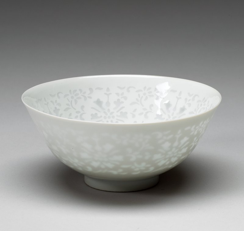 Bowl, one of a pair, white paste, pierced and filled with glaze, rice-grain floral motif. Egg-shell porcelain.