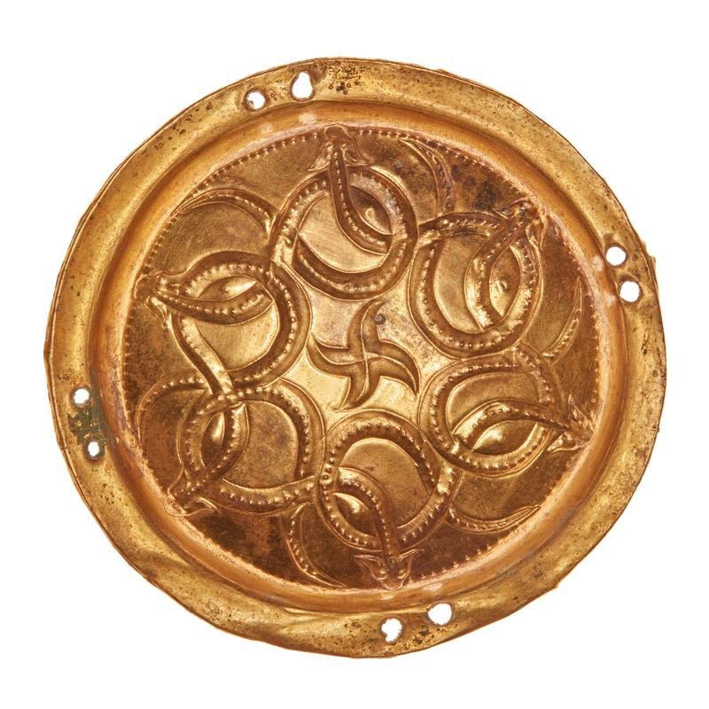 Made in Jincun; one of a pair of ornaments, round, animal style, interlaced serpents or hydra around central star-like form, bead pattern with simulated granulation; repousse, gold; heavy patina on back from bronze backing.
