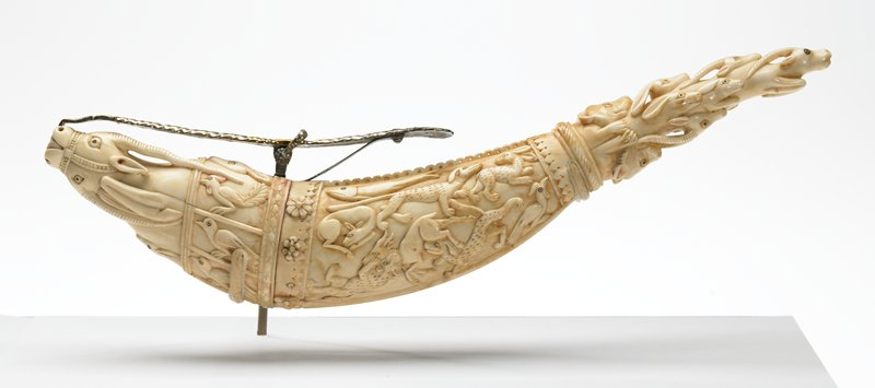 Powder Horn, carved ivory, with original silver fittings; carved images of wild animals; Mughal Dynasty