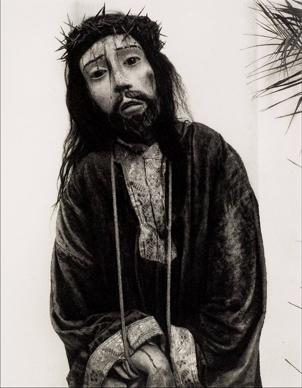 figure of Christ with crown of thorns and bloody face